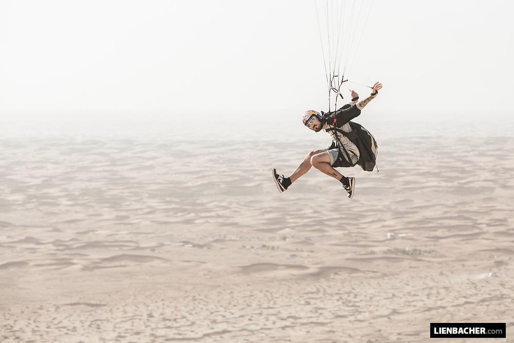 Marco Waltenspiel soars his little cloud in the desert of Dubai. March 2015