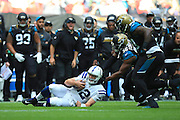 Andrew Luck of Indianapolis Colts slides for a first down during the International Series match between Indianapolis Colts and Jacksonville Jaguars at Wembley Stadium, London, England on 2 October 2016. Photo by Jason Brown.