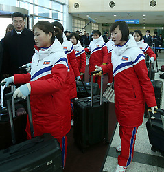 25 January 2018 - Paju, South Korea : (In this handout photos provided by Korea Pool) North Korean women hockey players arrive at the Inter-Korean Transit Office in Paju, South Korea on January 25, 2018. Twelve North Korean female hockey players crossed the border into South Korea to form the rivals' first-ever Olympic team during next month's 2018 Pyeongchang Winter Olympic Games. Photo Credit: Korea Pool