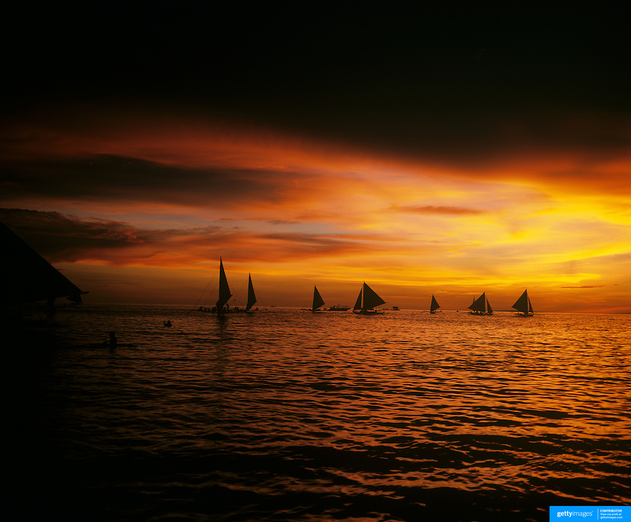Sailboats at sunset, White Beach, Boracay Island, The Phillippines. 23rd July 2011. Photo Tim Clayton
