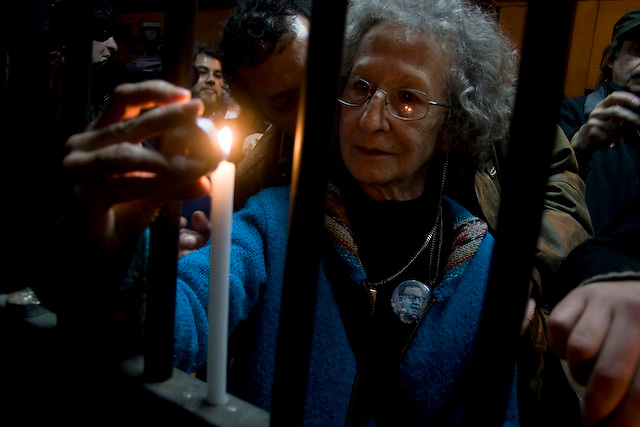 Mother of a victim put candles while participate in to a rally to conmemorate the victims of Pinichet's rule at Victor Jara stadium, a former torture center in Santiago, Thursday, Sept. 11, 2008. Chileans remember the 35th anniversary of the military coup head by former dictator Augusto Pinochet where presidet Allende dies.