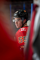 PENTICTON, CANADA - SEPTEMBER 11: Dillon Dube #59 of the Calgary Flames stands on the bench against the Winnipeg Jets on September 11, 2017 at the South Okanagan Event Centre in Penticton, British Columbia, Canada.  (Photo by Marissa Baecker/Shoot the Breeze)  *** Local Caption ***