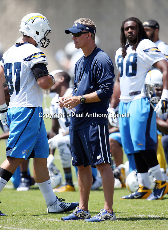 San Diego Chargers head coach Mike McCoy looks on during the San Diego Chargers Spring 2015 NFL minicamp practice on Wednesday, June 17, 2015 in San Diego. (©Paul Anthony Spinelli)