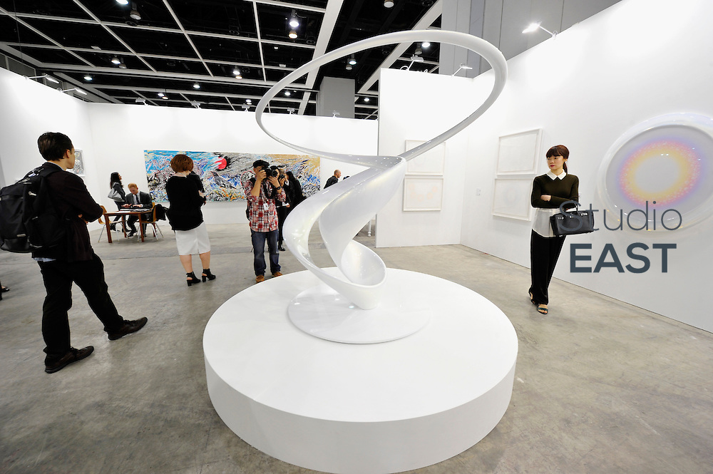 HONG KONG - MARCH 13:  Visitors look at sculpture 'Cycloid I' by Mariko Mori on the preview day of Art Basel art fair on March 13, 2015 in Hong Kong, Hong Kong.  (Photo by Lucas Schifres/Getty Images)