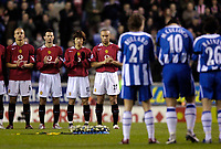 Photo: Jed Wee.<br /> Wigan Athletic v Manchester United. The Barclays Premiership. 06/03/2006.<br /> <br /> Manchester United and Wigan players applaud in memory of Wigan serviceman Lee Ellis who died while serving in Iraq.