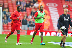 13.09.2014, Anfield, Liverpool, ENG, Premier League, FC Liverpool vs Aston Villa, 4. Runde, im Bild Liverpool's Mario Balotelli runs out at Anfield for the first time as he warms-up // during the English Premier League 4th round match between Liverpool FC and Aston Villa at the Anfield in Liverpool, Great Britain on 2014/09/13. EXPA Pictures &copy; 2014, PhotoCredit: EXPA/ Propagandaphoto/ David Rawcliffe<br /> <br /> *****ATTENTION - OUT of ENG, GBR*****
