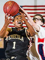 Justin Simon (1) of Temecula Valley reacts as Jacob Tryon (40) from Great Oak defends his layup attempt in league match up at Great Oak.  Image Credit: Amanda Schwarzer