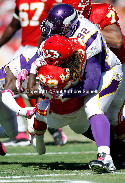 Kansas City Chiefs running back Dexter McCluster (22) gets gang tackled by Minnesota Vikings defensive tackle Remi Ayodele (92) and a teammate during the NFL week 4 football game against the Minnesota Vikings on Sunday, October 2, 2011 in Kansas City, Missouri. The Chiefs won the game 22-17. ©Paul Anthony Spinelli