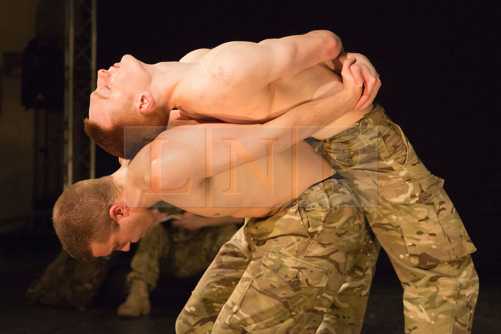 """© Licensed to London News Pictures. 07/05/2015. London, England. Male Duet performed by Duncan Anderson and Oliver Russell. The Rosie Kay Dance Company perform """"5 Soldiers: The Body is the Frontline"""" at The Rifles Officers' Club in Mayfair, London from 7 to 9 May 2015 before continuing a UK tour. 5 Soldiers gives an intimate view of the training that provides soldiers for combat and warfare and how the experience affects those that put their life on the line. Dancers: Duncan Anderson, Shelley Eva Haden, Chester Hayes, Sean Marcs and Oliver Russell. Choreographed and directed by Rosie Kay.  Photo credit: Bettina Strenske/LNP"""