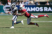 Los Angeles Rams wide receiver Brandin Cooks (12) tries to shake off a diving tackle attempt by Arizona Cardinals defensive back Jamar Taylor (28) as he catches a third quarter pass for a gain of 14 yards and a first down at the Cardinals 42 yard line during the 2018 NFL regular season week 2 football game against the Arizona Cardinals on Sunday, Sept. 16, 2018 in Los Angeles. The Rams won the game in a 34-0 shutout. (©Paul Anthony Spinelli)