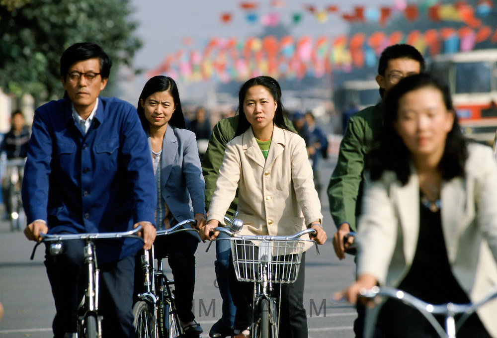 Chinese people using traditional bicycles for commuting in Peking, now Beijing, China in the 1980s