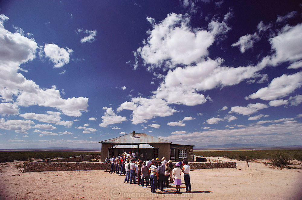 New Mexico, .First atomic bomb test site: Site Trinity, visitors lined up to enter the McDonald farmhouse, restored by the National Park Service. The world's first atomic bomb was assembled here before it was hoisted onto a tower for the detonation that ushered in the nuclear age. (1984).