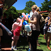 A family enoys cotton candy during the May Fair at Saint Mark's Church, New Canaan, Connecticut, USA. 12th May 2012. Photo Tim Clayton