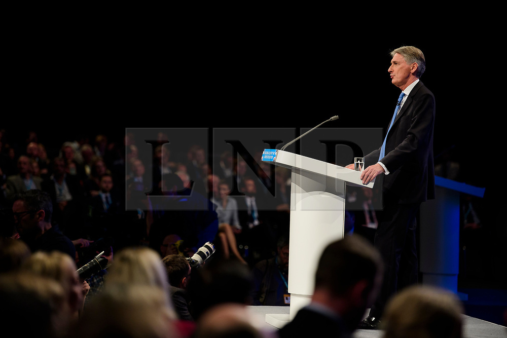 © Licensed to London News Pictures. 04/10/2017. Manchester, UK. Chancellor Philip hammond speaking at Conservative Party Conference. The four day event is expected to focus heavily on Brexit, with the British prime minister hoping to dampen rumours of a leadership challenge. Photo credit: Ben Cawthra/LNP