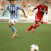 Wilmington Hammerheads FC's Steven Miller challenges Toronto FC's Nick Hagglund Wednesday June 18, 2014 at Legion Stadium in Wilmington, N.C. (Jason A. Frizzelle)