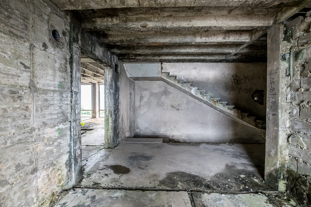 A staircase inside the abandoned Ducor Hotel, once the most prominent hotels in Monrovia, Liberia