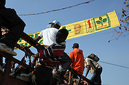A public transport truck passes under an election banner of the Lespwa party of René Préval. Port-au-Prince, Haiti, January 14, 2006.