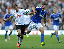 Ipswich Town's Tommy Smith jostles for the ball with Derby County's Jamie Ward  - Photo mandatory by-line: Dougie Allward/JMP - Mobile: 07966 386802 30/08/2014 - SPORT - FOOTBALL - Derby - iPro Stadium - Derby County v Ipswich Town - Sky Bet Championship