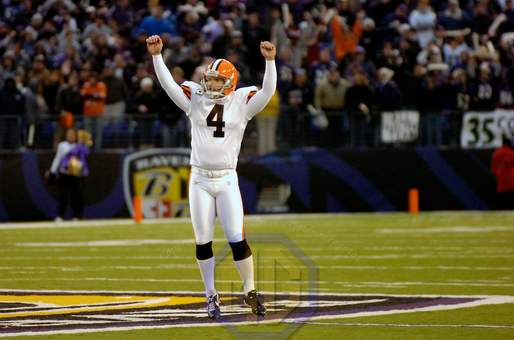 18 November 2007:  Cleveland Browns kicker Phil Dawson (4) raises his arms after a lengthy discussion by game officials ruled that his 51-yard field goal in the 4th quarter with no time remaining had passed through the uprights to tie the game against the Baltimore Ravens on November 18, 2007 at M&T Bank Stadium in Baltimore, Maryland. The Ravens were sent to their 4th consecutive loss with a 33-30 overtime time win by the Browns after Dawson kicked the game winning 33-yard field goal..