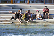 Some members of the Shanti Powa band, relax in a quiet corner along a canal in Expo 2015 before a live performance at the stand of the South Tyrol region, Rho-Pero, Milan, June 27, 2015.<br /> <br /> Alcuni copomponenti della band Shanti Powa si rilassano in un angolo tranquillo lungo un canale di Expo 2015 prima di una esibizione dal vivo allo stand della regione Alto Adige, Rho-Pero, Milano, 27 giugno 2015.
