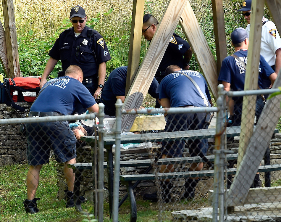7/7/16 :: NEWS :: STAFF :: New London first responders tend to the victim of an apparent overdose on the grounds of the Old Towne Mill on Mill St. Thursday, July 7, 2016. (Sean D. Elliot/The Day)