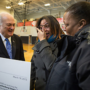 WASHINGTON,DC - MAR18: Lashae Hunter, a senior at Cesar Chavez Public Charter School for Public Policy, was surprised at school with a hand-delivered acceptance letter and full scholarship from George Washington University President Steven Knapp, March 18, 2015, through the Stephen Joel Trachtenberg Scholarship program, while her mother Warrenrenia Hunter looks on. (Photo by Evelyn Hockstein/For The Washington Post)