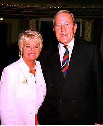 TV presenter JUDITH CHALMERS and her husband MR NEIL DURDEN-SMITH, at a luncheon in London on 21st October 1998.MLA 33