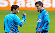 NETHERLANDS, HOENDERLOO : Dutch international football player Ibrahim Afellay (l) speaks with Robin van Persie   at the trainingcamp of the Netherlands national football team in Hoenderloo on May 31, 2012. AFP PHOTO/ ROBIN UTRECHT