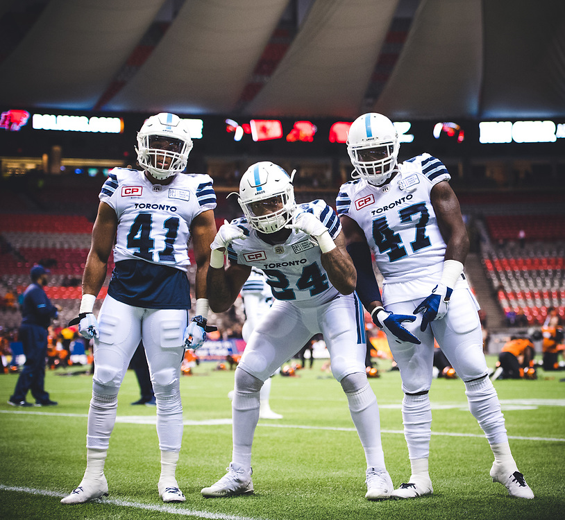 Nakas Onyeka (41), Justin Tuggle (24) and Terrance Plummer (47) of the Toronto Argonauts before the game against the BC Lions at BC Place Stadium in Vancouver, BC, Saturday Nov. 4, 2017. (Photo: Johany Jutras)
