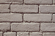 Close up of a gray painted brick wall.