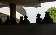 Students participate in graduate commencement ceremonies. Photo by Ben Siegel