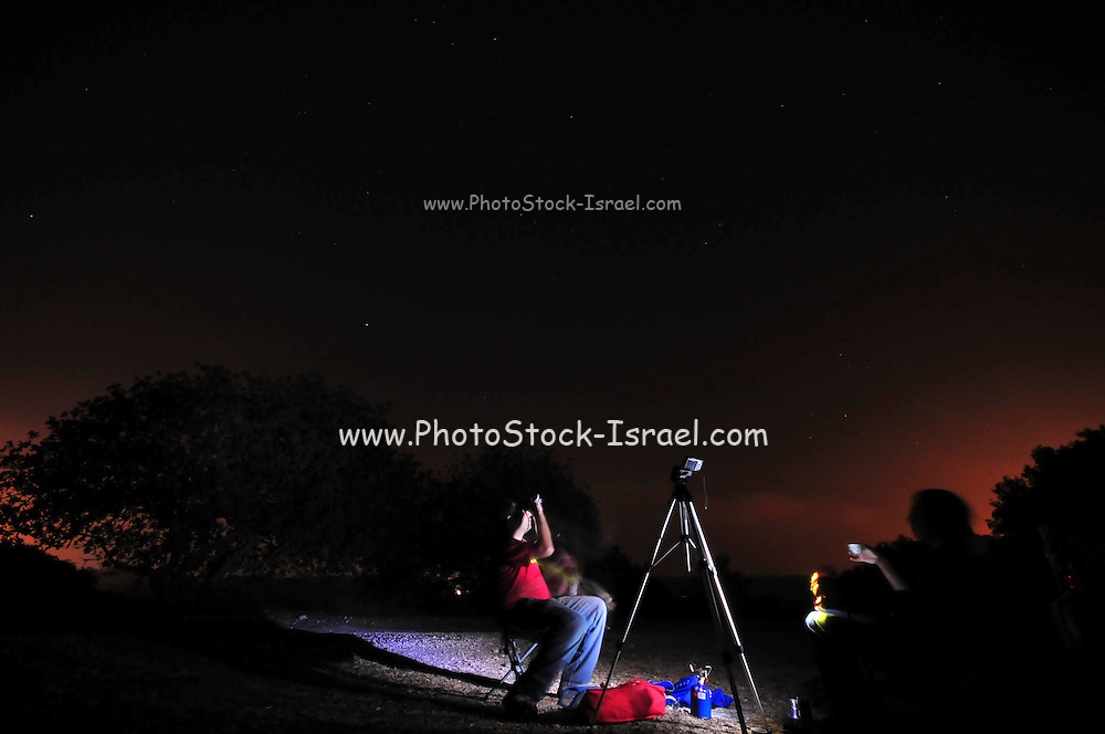 Photographers ready themselves for a night shot of a meteorite sower