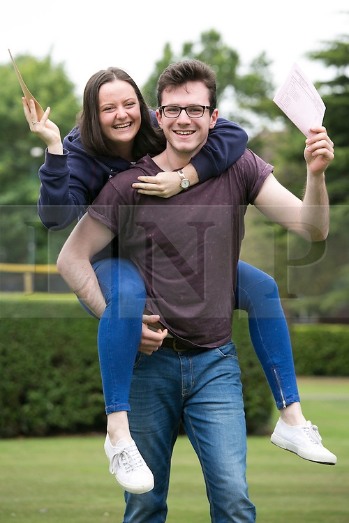 © Licensed to London News Pictures. 13/08/2015. Solihull, West Midlands, UK. A level results day at Solihull School. A record breaking year for the school as it had 88% of students with A Star to B passes. Pictured, Poppy Eales and Joe Price celebrate. Photo credit : Dave Warren/LNP