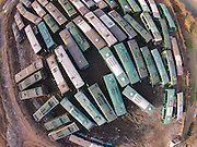 HANGZHOU, CHINA - DECEMBER 17: (CHINA OUT) <br /> <br /> China's Junk Yard for Buses<br /> <br /> One hundred junked public buses park at Douyunhe Villiage Parking Station on December 18, 2014 in Hangzhou, Zhejiang province of China. The junked public buses would be recollected by recycling companies firstly, then sent to Ningbo's Ministry of Public Security to be disassembled, and finally be back to steel plants for new usage. <br /> ©Exclusivepxi Media