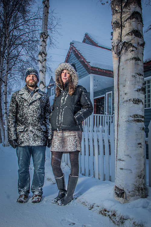 """We were let of work early due to bad weather.  It's Alaska for heaven sakes!""  -Bryon Taylor and Kyrsti Flooden walk to their car after getting off work early due to bad weather, Anchorage"