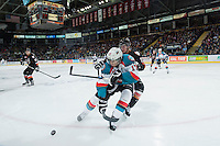KELOWNA, CANADA - FEBRUARY 28: Jake Bean #2 of Calgary Hitmen checks Rodney Southam #17 of Kelowna Rockets during first period on February 28, 2015 at Prospera Place in Kelowna, British Columbia, Canada.  (Photo by Marissa Baecker/Shoot the Breeze)  *** Local Caption *** Rodney Southam; Jake Bean;