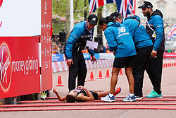© Licensed to London News Pictures. 28/04/2019. London, UK. A women runner gets medical help at the finish line of 2019 Virgin Money London Marathon. Photo credit: Dinendra Haria/LNP