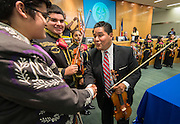 Richard Carranza talks with members of the Northside and Heights Mariachi bands after being hired to be superintendent of the Houston ISD, August 18, 2016.