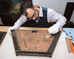 Conservator Jonathan Santa Maria Bouquet works on an 18th century dulcimer as part of the newly-refurbished St Cecilia's Hall, which has just undergone a 2 year, £6.5 million refurbishment which will see more of the University of Edinburgh's musical instrument collection on display to the public.<br />