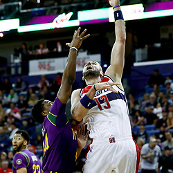Jan 29, 2017; New Orleans, LA, USA; Washington Wizards center Marcin Gortat (13) shoots over New Orleans Pelicans forward Solomon Hill (44) during the first quarter of a game at the Smoothie King Center. Mandatory Credit: Derick E. Hingle-USA TODAY Sports