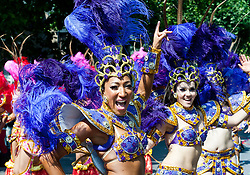 Women dancing in the streets at the 2013 Notting Hill Carnival in West London, United Kingdom. Monday, 26th August 2013. Picture by Piero Cruciatti / i-Images