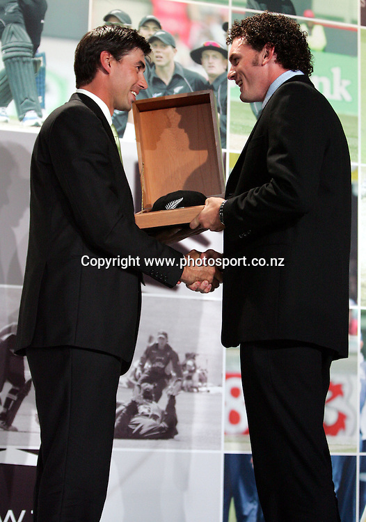 New Zealand captain Stephen Fleming presents Kyle Mills with his new Black Cap at the National Bank New Zealand Cricket Awards, Langham Hotel, Auckland, New Zealand on Thursday 31 March, 2005. Photo: Hannah Johnston/PHOTOSPORT<br />