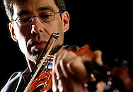 Misha Parshenov plays one of the violins that he made from scratch.  He quotes the violins that he makes as around 15,000 dollars.  He was trained as a violinist in Russia since he was five years old.