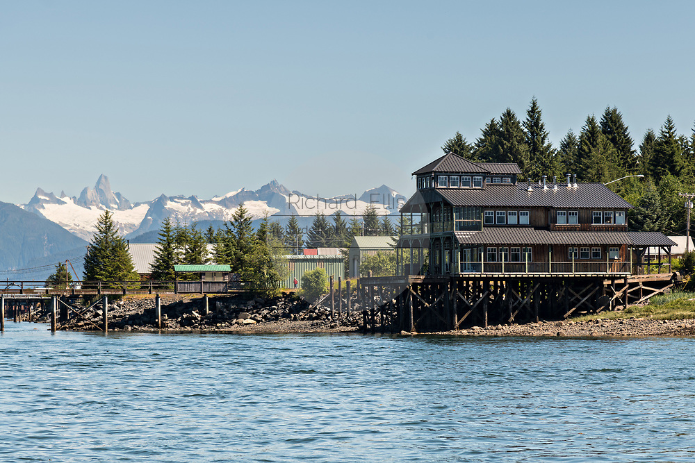 The tiny village of Petersburg on Mitkof Island along the Wrangell Narrows in Frederick Sound with the Alaska Coast Range of mountains behind on Mitkof Island, Alaska. Petersburg settled by Norwegian immigrant Peter Buschmann is known as Little Norway due to the high percentage of people of Scandinavian origin.