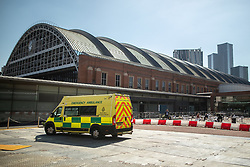 © Licensed to London News Pictures . 14/04/2020. Manchester, UK. An ambulance arrives at the hospital . The National Health Service has built a 648 bed field hospital for the treatment of Covid-19 patients , at the historical railway station terminus which now forms the main hall of the Manchester Central Convention Centre . The facility is due to open this week (commencing Easter Monday , 13th April 2020 ) and will treat patients from across the North West of England , providing them with general medical care and oxygen therapy after discharge from Intensive Care Units . Photo credit : Joel Goodman/LNP