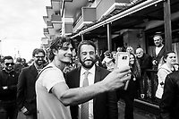 VILLAFRANCA TIRRENA, ITALY - 27 OCTOBER 2017: Five Star Movement (Italian: Movimento 5 Stelle, or M5S) candidate Giancarlo Cancelleri (center), running for governor of Sicily in the upcoming Sicilan regional election, takes a selfie with a supporter in Villafranca Tirrena, Italy, during his campaign on October 27th 2017. <br /> <br /> The Sicilian regional election for the renewal of the Sicilian Regional Assembly and the election of the President of Sicily will be held on 5th November 2017.