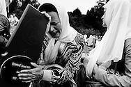 A widow mourns her husband killed in the Srebrenica massacre.