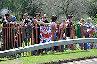 Crowds gather along the streets to see the Olympic Torch Relay passes through Hatfield, Herts,