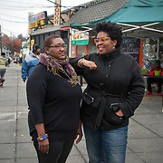 WASHINGTON, DC - NOV 16 :  Kimberly Gaines (right) and Seshat Walker (left), community organizers who are profiling interesting people in their Deanwood neighborhood, stand outside the Riverside Center, November 16, 2013, in Deanwood, Washington, DC. Their project is called My Deanwood, and they photograph community members and write stories about them. (Photo by Evelyn Hockstein/For The Washington Post)