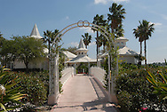 A view of the entrance and connecting bridge leading to the Disney Wedding Pavilion, where couples tie the know in Disney fashion, in Lake Buena Vista, Florida.